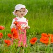 Baby-girl with red flower — Stockfoto