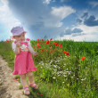 Baby on a lane amongst a field - Stock Photo