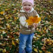 Baby with leaves — Stock Photo