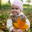Nice baby with leaves — Stock Photo