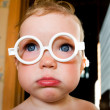 Baby in toy-glasses - Foto Stock