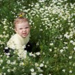 Baby-girl with white flowers — Stock Photo