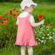 Child with red flower — Foto de Stock