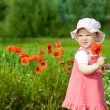 Baby with red flower — Stock Photo #8665381