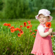 Baby with red flower - Stock Photo