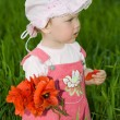 Baby with red flower — Stock Photo