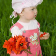 Baby with red flower — Stockfoto