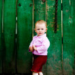 Baby near fence — Stock Photo