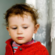 Broody little boy - Stock Photo