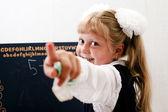Little girl near chalkboard — Stok fotoğraf