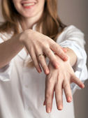 A woman showing her hands — Stock Photo