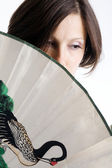 Woman with a fan — Stock Photo