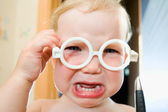 Baby in toy-glasses — Stock Photo
