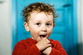 Watchful little boy with dishevelled hair — Stock Photo