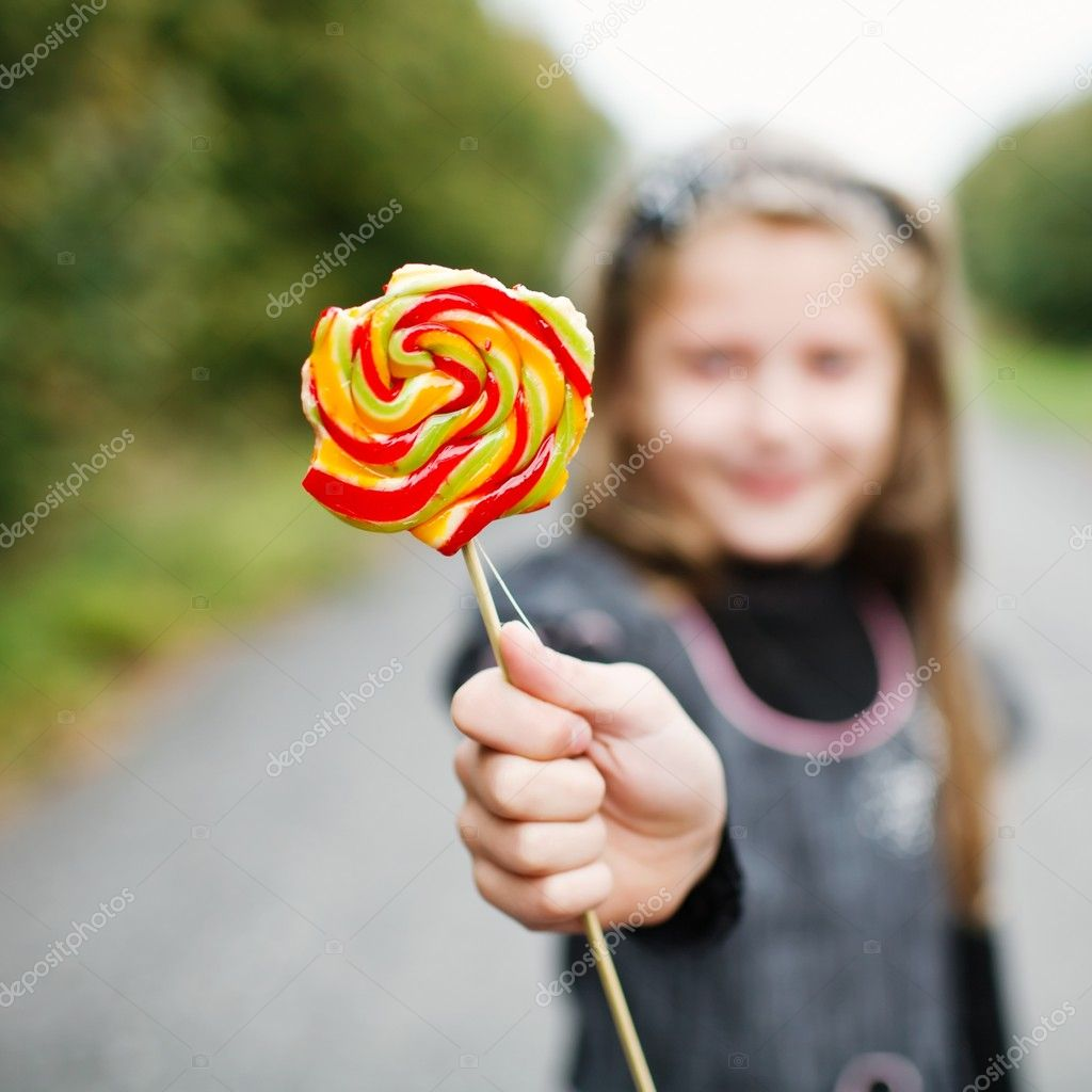 An image of girl wit lollipop in his hand — Stock Photo #8660071