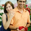 A young couple with a flower — Stock Photo