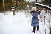 Little girl playing snowballs — Stock Photo