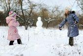 Little girls playing snowballs — Stock Photo