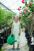Girl with a watering can — Stock Photo