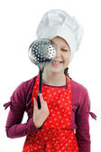 A girl with a colander in her hands — Stock Photo