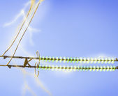 Electric line against the blue sky — Stock Photo