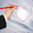 Hand with pencil draws the heart — Stock Photo #8720848