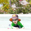 Adorable toddler by the pool — Stock Photo