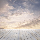 Sunset sky and wood floor — Stock fotografie