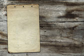 Vintage paper on wood texture — Stockfoto