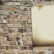 paper on brickwall — Stock Photo