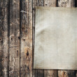 Paper on old wood texture — Stock Photo
