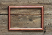 Photo frame on wooden wall — Stock Photo