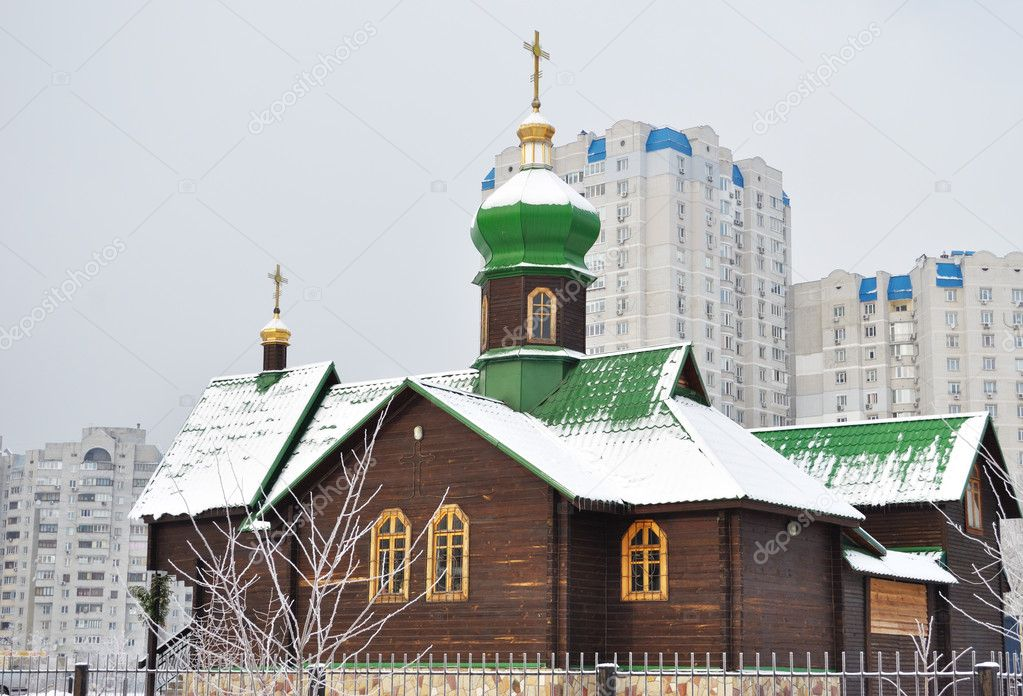 Orthodoxy church on a background municipal landscape — Stock Photo #8672804