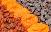 Dried apricots and raisins are two types of — Stock Photo