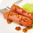 Sausages with mustard — Stock Photo
