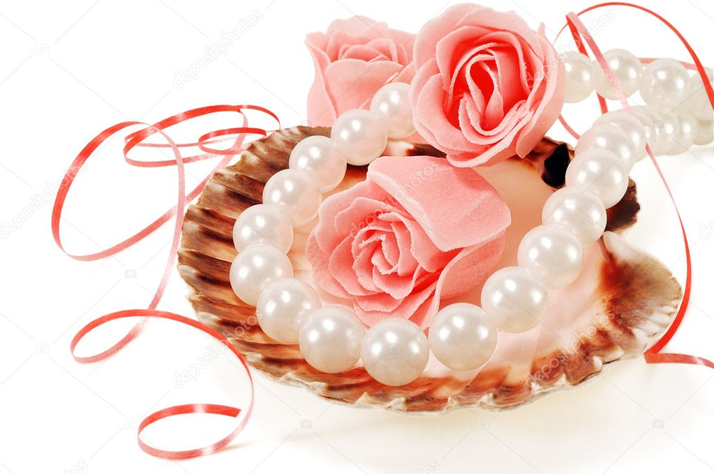 Sea shell with pearls and a rose on a white background  Stock Photo #8789076