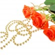 Three roses with beads — Stock Photo