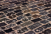 Old cobblestone road — Stockfoto