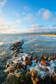 Stones in sea water — Stock Photo