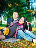 Loving parents in park — Stock Photo