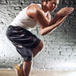 Young man sports exercises - Stock Photo