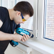 Man worker mounting window — Stock Photo #8610756