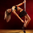 Young sexy pole dance woman — Stock Photo