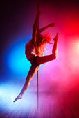 Young pole dance woman — Stock Photo