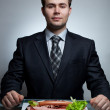 Young businessman eating — Stock Photo #9935607
