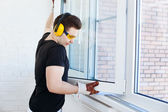 Man worker mounting window — Stock Photo