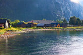 Buildings on fjord shore — Stock Photo