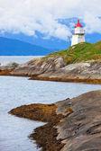 Lighthouse on fjord coast — Stock Photo