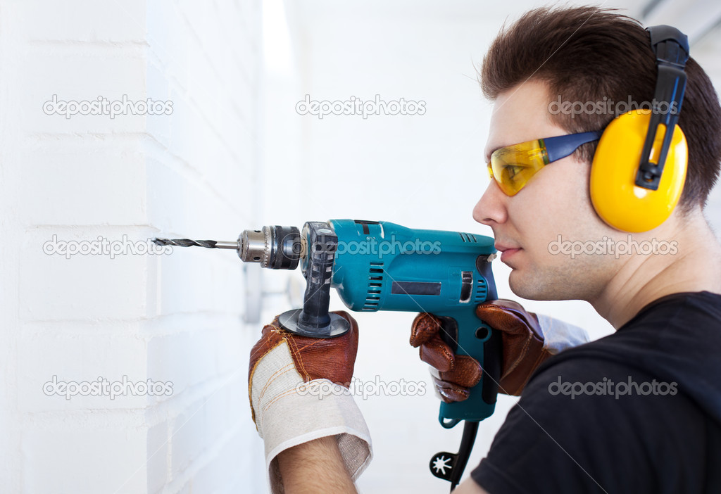 Man worker with drill. Bright white colors. — Stock Photo #9935574