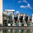 Industrial power plant with smokestack — Stock Photo